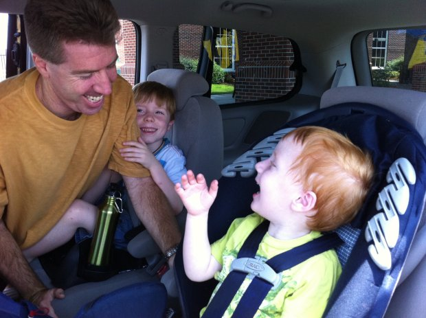 Both boys are overjoyed to reunite with their dad. We had been on the East Coast for two weeks before he joined us. This picture was taken at the airport.